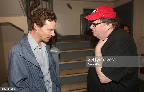 Benedict Cumberbatch and Michael Moore chat backstage at the hit play 'Michael Moore The Terms of My Surrender' on Broadway at The Belasco Theatre on...