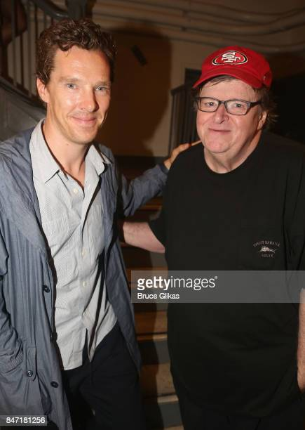 Benedict Cumberbatch and Michael Moore pose backstage at the hit play 'Michael Moore The Terms of My Surrender' on Broadway at The Belasco Theatre on...