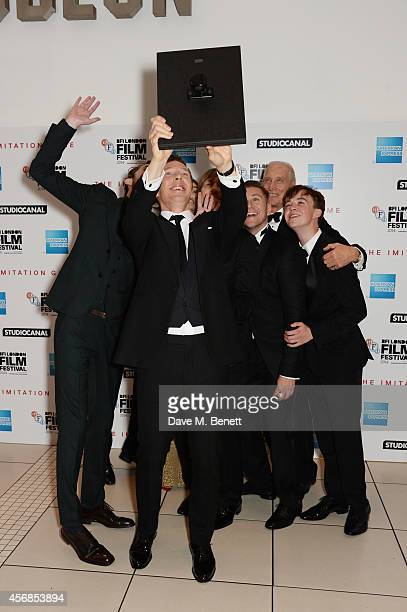 Benedict Cumberbatch leads cast and crew in a selfie at the Opening Night Gala Screening of 'The Imitation Game' during the 58th London Film Festival...