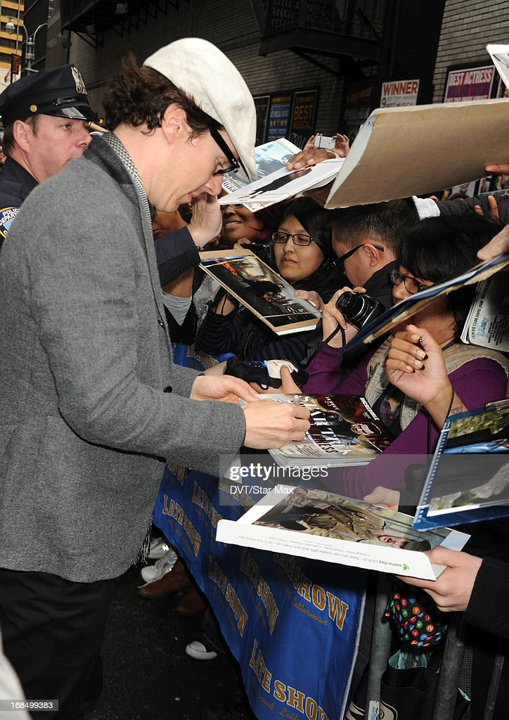 Benedict Cumberbatch signs autographs on May 9, 2013 in New York City.