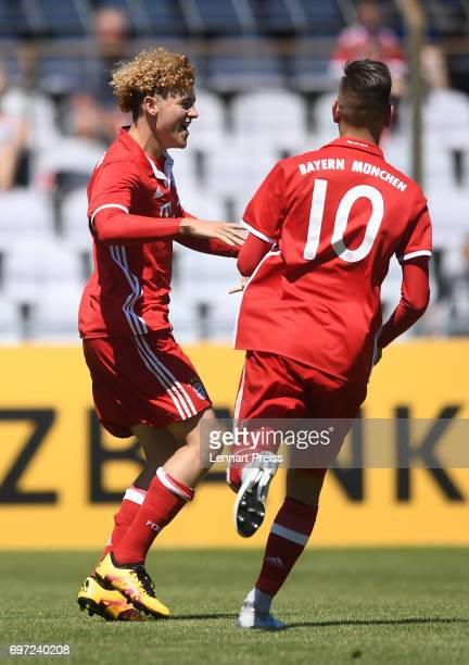 Benedict Hollerbach and Marcel Zylla of FC Bayern Muenchen celebrate scoring their side's second goal during the B Juniors German Championship Final...