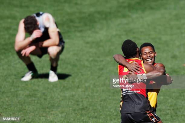 Benedict TIRANG of Papua New Guinea celebrates the win on the siren during the 2017 AFL International Cup Grand FInal match between New Zealand and...