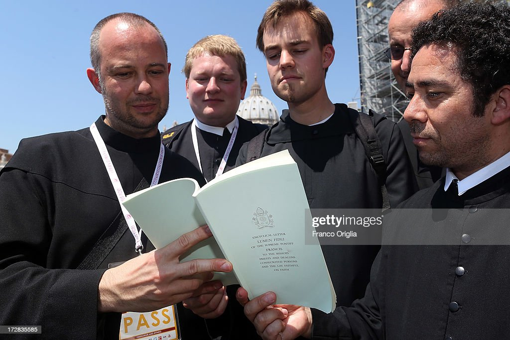 Benedictine friars read Pope Francis' first encyclical, entitled 'Lumen Fidei' (The Light of Faith) in St. Peter's Square during a press conference at the Holy See Press Office on July 5, 2013 in Vatican City, Vatican. The document continues many of Benedict's favourite themes, from the complementarity of faith and reason, to the joy of a personal encounter with Christ. Firmly situated in the Year of Faith, it's also set in the context of the 50th anniversary of the Second Vatican Council, which re-established the central role of Faith at the heart of all human relationships.