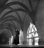 Benedictine monk in meditation in the cloister of the SaintWandrille abbey about 1935