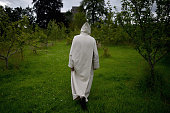 Benedictine monks work in a garden at Pluscarden Abbey on July 20 2015 in Elgin Scotland Monks at Abbey which owes its foundation to King Alexander...
