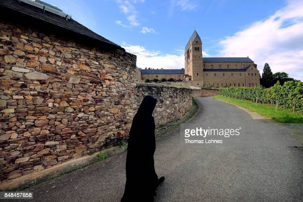 A benedictine nun walks through the vineyard to the abbey 'St Hildegard' after the annual procession during the Catholic Hildegard Pilgrimage events...