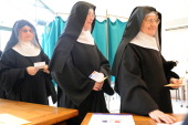 Benedictine nuns from the SainteCecile abbey queue for casting their ballot at a polling station in Solesmes western France on March 27 during the...