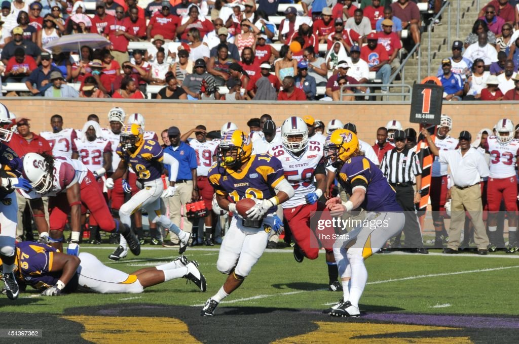 Benedict's Jevric Blocker (12) runs the ball during the first quarter against South Carolina State in the 2014 Palmetto City Classic in Columbia, S.C., on Saturday, Aug. 30, 2014.