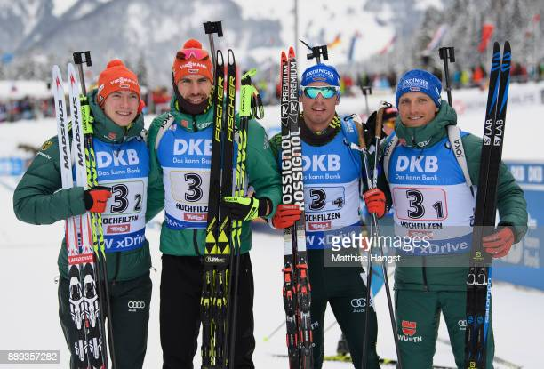 Benedikt Doll of Germany Arnd Peiffer of Germany Simon Schempp of Germany and Erik Lesser of Germany celebrate after the Men's 4x75km relay...