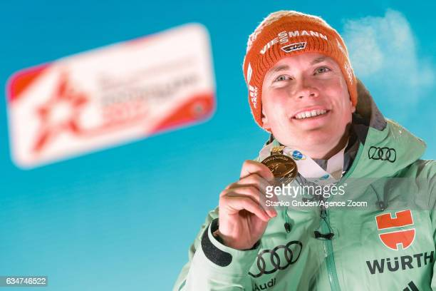 Benedikt Doll of Germany wins the gold medal during the IBU Biathlon World Championships Men's Sprint on February 11 2017 in Hochfilzen Austria