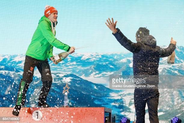 Benedikt Doll of Germany wins the gold medal Martin Fourcade of France wins the bronze medal during the IBU Biathlon World Championships Men's Sprint...