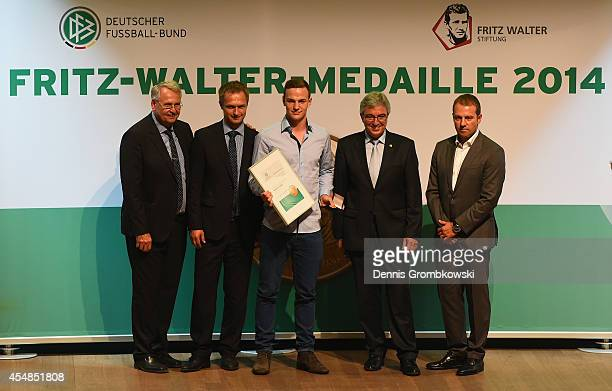 Benedikt Gimber is honored with the U17 Fritz Walter Medal in Gold at the Fritz Walter Medal Awarding Ceremony on September 7 2014 in Essen Germany