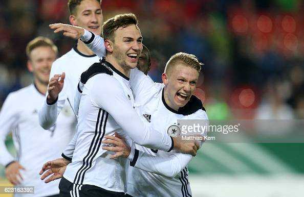 Benedikt Gimber of Germany jubilates with team mate Philipp Ochs after scoring the first goal during the U20 international friendly match between...