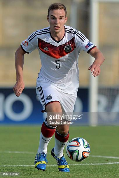 Benedikt Gimber of Germany runs with the ball during the UEFA Under17 European Championship 2014 group B match between Germany and Scotland at...