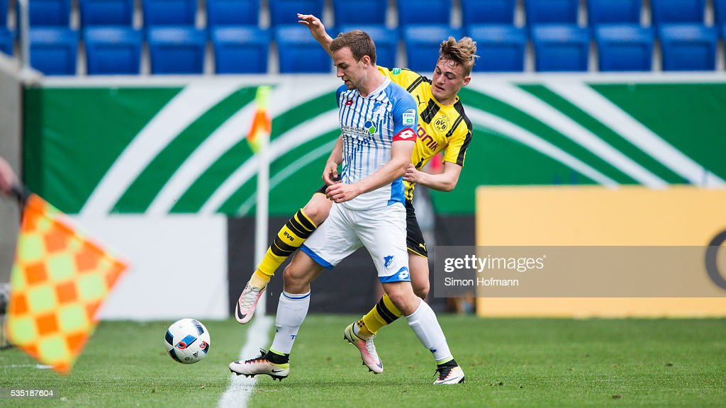 <a gi-track='captionPersonalityLinkClicked' href=/galleries/search?phrase=Benedikt+Gimber&family=editorial&specificpeople=9718811 ng-click='$event.stopPropagation()'>Benedikt Gimber</a> of Hoffenheim is challenged by Jacob Bruun Larsen of Dortmund during the A Juniors German Championship Final match between 1899 Hoffenheim U19 and Borussia Dortmund U19 at Wirsol Rhein-Neckar-Arena on May 29, 2016 in Sinsheim, Germany.