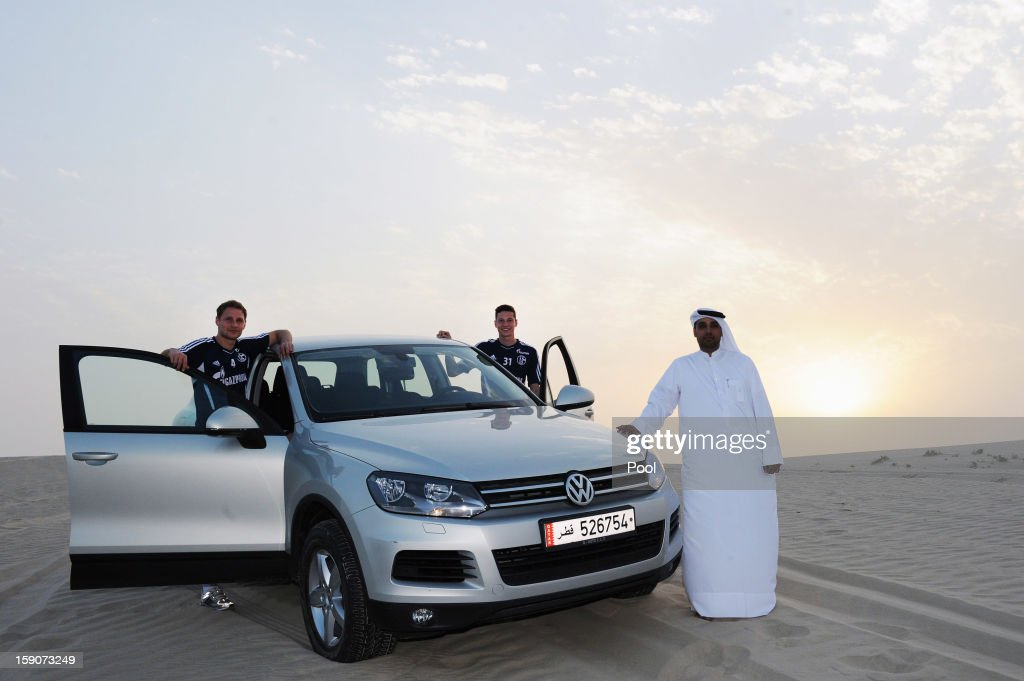 Benedikt Hoewedes (L) and Julian Draxler of Schalke pose during a trip to the desert outside Doha at the Schalke 04 training camp on January 7, 2013 in Doha, Qatar.