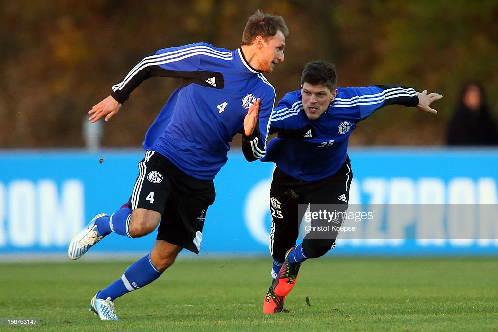 Benedikt Hoewedes and Klaas-Jan Huntelaar of Schalke 04 attend the training session at the training ground ahead of the UEFA Champions League group B match between FC Schalke 04 and Olympiakos Piraeus on November 21, 2012 in Gelsenkirchen, Germany.