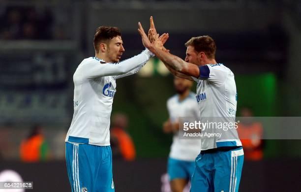 Benedikt Hoewedes and Leon Goretzka of Schalke celebrate the 21 against Moenchengladbach during the UEFA Europa League round of 16 soccer match...