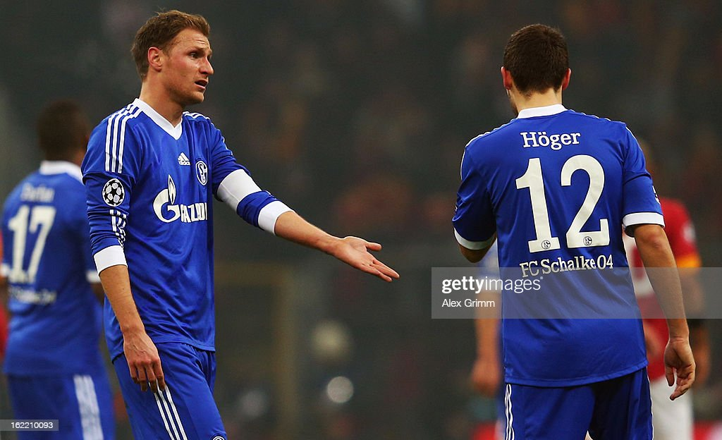 Benedikt Hoewedes (L) and Marco Hoeger of Schalke react during the UEFA Champions League Round of 16 first leg match between Galatasaray and FC Schalke 04 at the Turk Telekom Arena on February 20, 2013 in Istanbul, Turkey.
