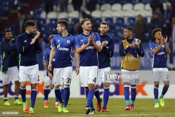 Benedikt Hoewedes and team mates of Schalke celebrate with the fans after the UEFA Europa League Round of 32 second leg match between FC Schalke 04...