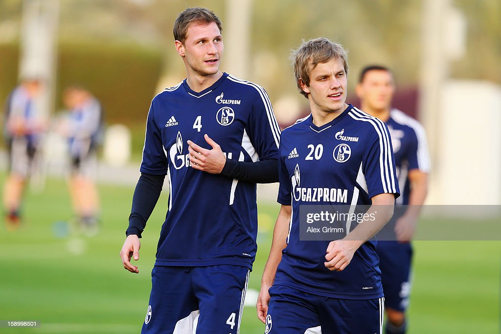 <a gi-track='captionPersonalityLinkClicked' href=/galleries/search?phrase=Benedikt+Hoewedes&family=editorial&specificpeople=3945465 ng-click='$event.stopPropagation()'>Benedikt Hoewedes</a> (L) and Teemu Pukki arrive for a Schalke 04 training session at the ASPIRE Academy for Sports Excellence on January 5, 2013 in Doha, Qatar.