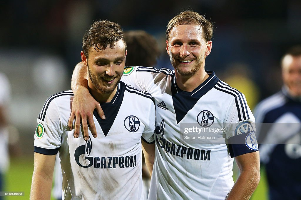 <a gi-track='captionPersonalityLinkClicked' href=/galleries/search?phrase=Benedikt+Hoewedes&family=editorial&specificpeople=3945465 ng-click='$event.stopPropagation()'>Benedikt Hoewedes</a> (R) celebrates winning with <a gi-track='captionPersonalityLinkClicked' href=/galleries/search?phrase=Marco+Hoeger&family=editorial&specificpeople=6872414 ng-click='$event.stopPropagation()'>Marco Hoeger</a> of Schalke (L) after the DFB Cup second round match between Darmstadt 98 and Schalke 04 at Stadion am Boellenfalltor on September 25, 2013 in Darmstadt, Germany.