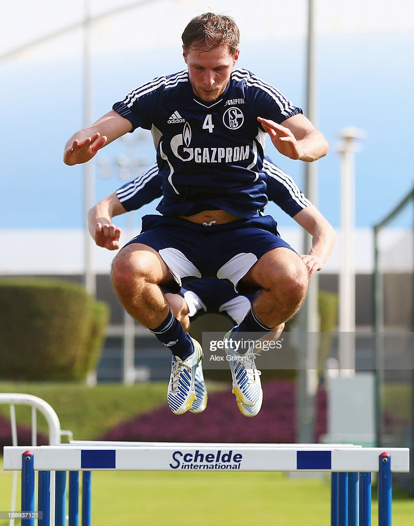 <a gi-track='captionPersonalityLinkClicked' href=/galleries/search?phrase=Benedikt+Hoewedes&family=editorial&specificpeople=3945465 ng-click='$event.stopPropagation()'>Benedikt Hoewedes</a> exercises during a Schalke 04 training session at the ASPIRE Academy for Sports Excellenc on January 4, 2013 in Doha, Qatar.