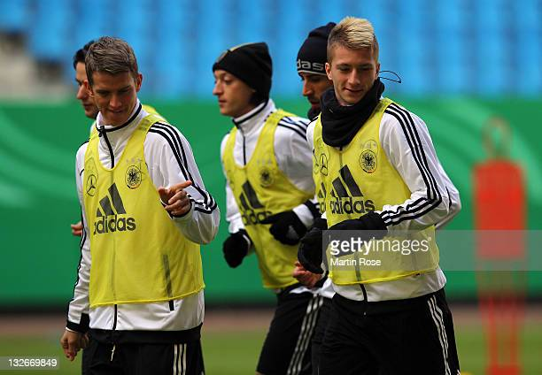 Benedikt Hoewedes jokes with team mate Marco Reus during the German National team training session at Imtech Arena on November 13 2011 in Hamburg...