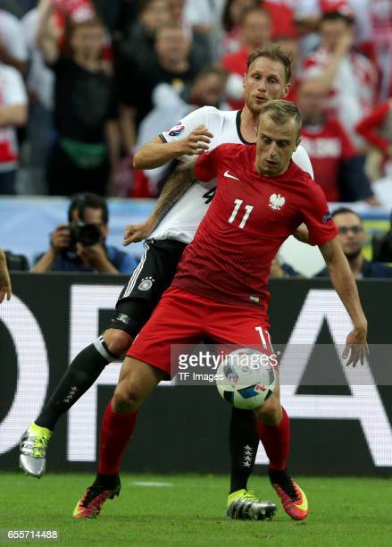 Benedikt Hoewedes of Germany and Kamil Grosicki of Poland battle for the ball during the UEFA EURO 2016 Group C match between Germany and Poland at...