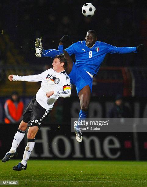 Benedikt Hoewedes of Germany and Mario Barwuah Balotelli of Italy fight for the ball during the men's U21 international friendly match between...