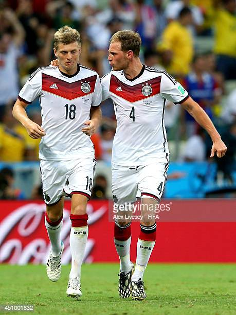 Benedikt Hoewedes of Germany celebates setting up his team's second goal with his teammate Toni Kroos during the 2014 FIFA World Cup Brazil Group G...