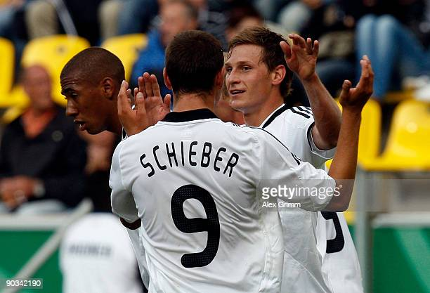 Benedikt Hoewedes of Germany celebrates his team's fifth goal with team mates Julian Schieber and Jerome Boateng during the UEFA U21 Championship...