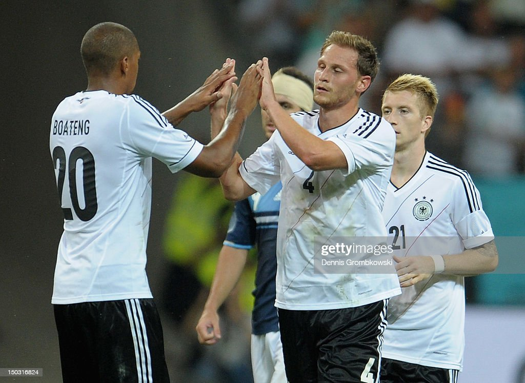Benedikt Hoewedes of Germany celebrates with teammate Jerome Boateng after scoring his team's first goal during the international friendly match between Germany and Argentina and Commerzbank-Arena on August 15, 2012 in Frankfurt am Main, Germany.