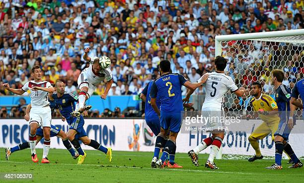 Benedikt Hoewedes of Germany heads the ball hitting a post during the 2014 FIFA World Cup Brazil Final match between Germany and Argentina at...