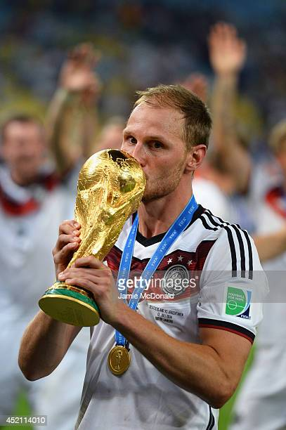 Benedikt Hoewedes of Germany kisses the World Cup trophy after defeating Argentina 10 in extra time during the 2014 FIFA World Cup Brazil Final match...