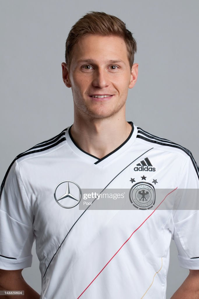 <a gi-track='captionPersonalityLinkClicked' href=/galleries/search?phrase=Benedikt+Hoewedes&family=editorial&specificpeople=3945465 ng-click='$event.stopPropagation()'>Benedikt Hoewedes</a> of Germany poses during a national team photocall on November 14, 2011 in Hamburg, Germany.