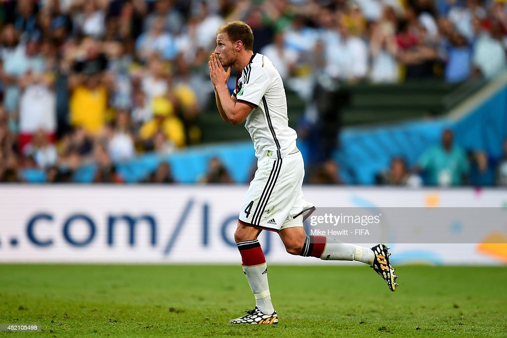 <a gi-track='captionPersonalityLinkClicked' href=/galleries/search?phrase=Benedikt+Hoewedes&family=editorial&specificpeople=3945465 ng-click='$event.stopPropagation()'>Benedikt Hoewedes</a> of Germany reacts after his head hitting a post during the 2014 FIFA World Cup Brazil Final match between Germany and Argentina at Maracana on July 13, 2014 in Rio de Janeiro, Brazil.