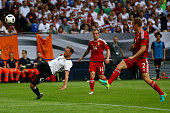 benedikt Hoewedes of Germany shoots the ball during the International Friendly match between Germany and Hungary at VeltinsArena on June 4 2016 in...