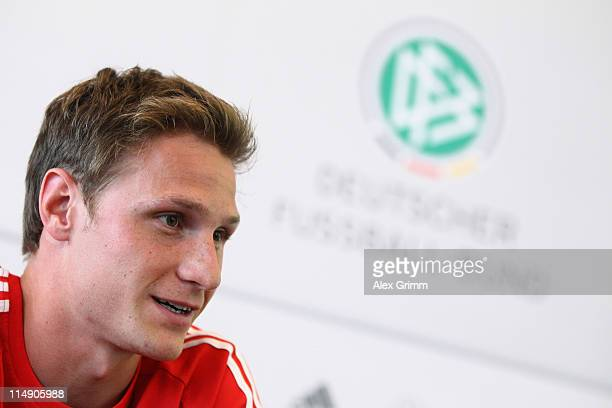 Benedikt Hoewedes of Germany talks to the media during a press conference at the DFB headquarters on May 28 2011 in Frankfurt am Main Germany