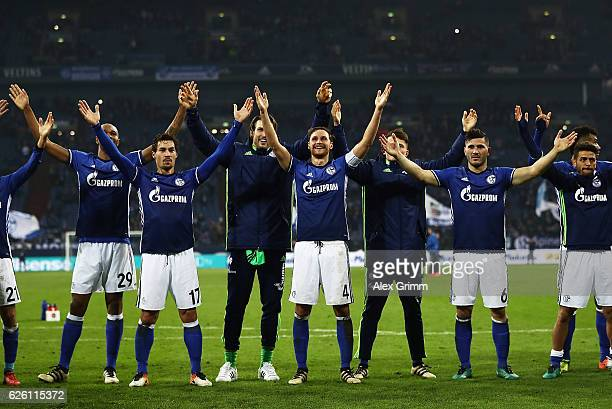 Benedikt Hoewedes of Schalke 04 and team mates thank their fans after victory in the Bundesliga match between FC Schalke 04 and SV Darmstadt 98 at...