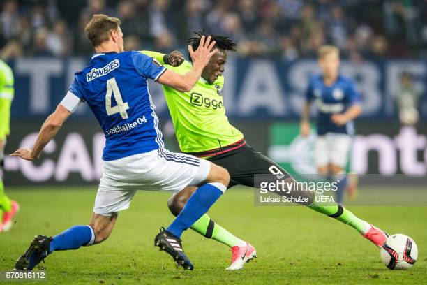 Benedikt Hoewedes of Schalke and Bertrand Traore of Amsterdam in action during the UEFA Europa League quarter final second leg match between FC...