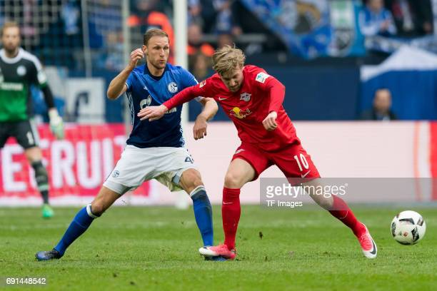 Benedikt Hoewedes of Schalke and Emil Forsberg of Leipzig battle for the ball during the Bundesliga match between FC Schalke 04 and RB Leipzig at...