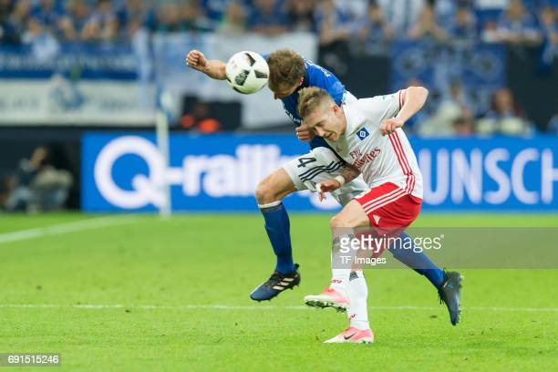 Benedikt Hoewedes of Schalke and Lewis Holtby of Hamburg battle for the ball during to the Bundesliga match between FC Schalke 04 and Hamburger SV at...