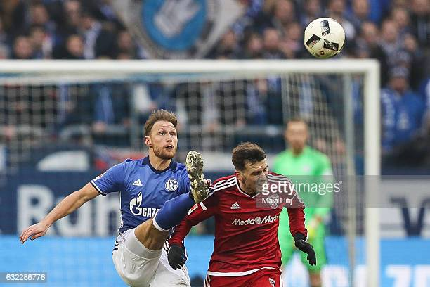 Benedikt Hoewedes of Schalke and Pascal Gross of Ingolstadt fight for the ball during the Bundesliga match between FC Schalke 04 and FC Ingolstadt 04...