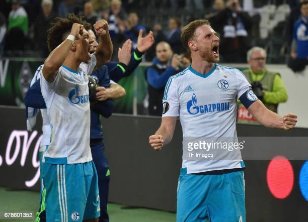 Benedikt Hoewedes of schalke and Thilo Kehrer of Schalke celebrate their win during the UEFA Europa League Round of 16 second leg match between...