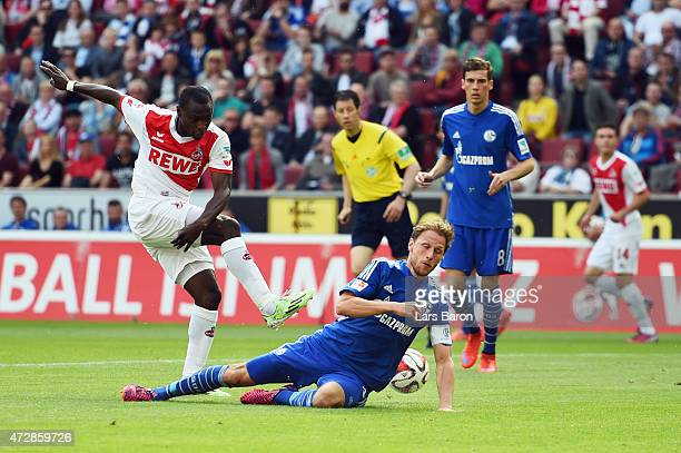 Benedikt Hoewedes of Schalke blocks a shot of Anthony Ujah of Koeln during the Bundesliga match between 1 FC Koeln and FC Schalke 04 at...