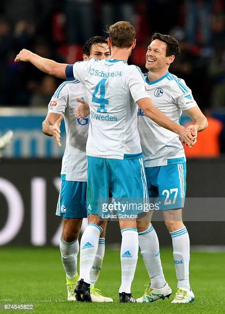 Benedikt Hoewedes of Schalke celebrate victory with his team mates during the Bundesliga match between Bayer 04 Leverkusen and FC Schalke 04 at...