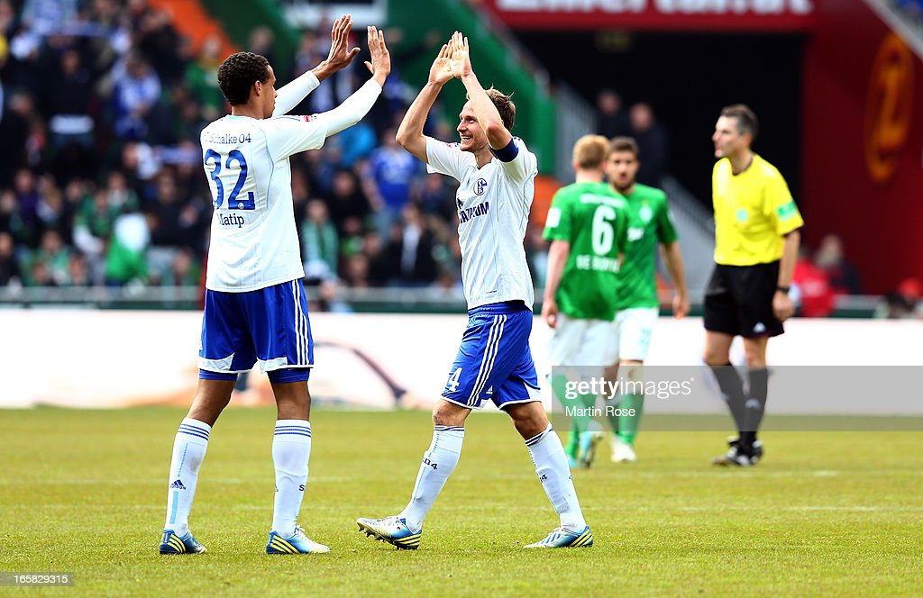 Benedikt Hoewedes (R) of Schalke celebrate with team mate <a gi-track='captionPersonalityLinkClicked' href=/galleries/search?phrase=Joel+Matip&family=editorial&specificpeople=4462851 ng-click='$event.stopPropagation()'>Joel Matip</a> after the Bundesliga match between Werder Bremen and FC Schalke 04 at Weser Stadium on April 6, 2013 in Bremen, Germany.