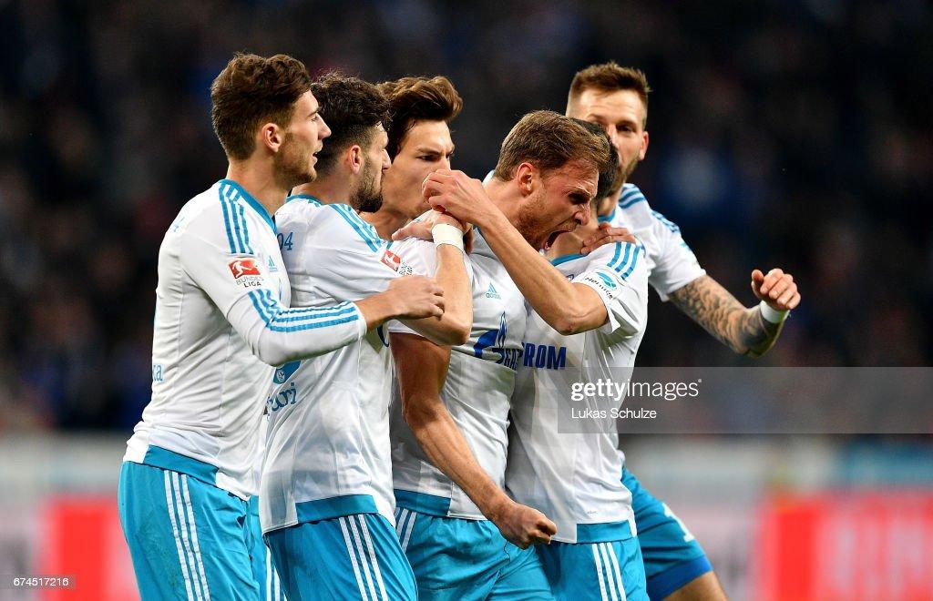 Benedikt Hoewedes (C) of Schalke celebrates after he scores the 2nd goal goal during the Bundesliga match between Bayer 04 Leverkusen and FC Schalke 04 at BayArena on April 28, 2017 in Leverkusen, Germany.