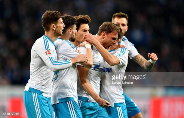 Benedikt Hoewedes of Schalke celebrates after he scores the 2nd goal goal during the Bundesliga match between Bayer 04 Leverkusen and FC Schalke 04...